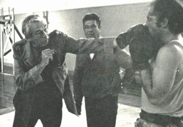 John Huston demonstrates boxing technique while directing the 1972 feature film, Fat City.
